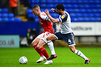 Fleetwood Town's Paul Coutts vies for possession with Bolton Wanderers' Jason Lowe<br /> <br /> Photographer Richard Martin-Roberts/CameraSport<br /> <br /> The EFL Sky Bet League One - Bolton Wanderers v Fleetwood Town - Saturday 2nd November 2019 - University of Bolton Stadium - Bolton<br /> <br /> World Copyright © 2019 CameraSport. All rights reserved. 43 Linden Ave. Countesthorpe. Leicester. England. LE8 5PG - Tel: +44 (0) 116 277 4147 - admin@camerasport.com - www.camerasport.com