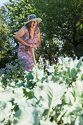 Cheerful senior woman working in the garden, Altoetting, Bavaria, Germany