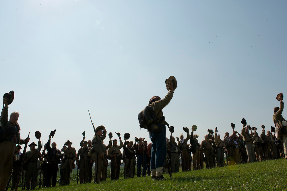 14th Tennessee infantry Confederate soldiers raise their hats in appreciation to volunteers who provided food and water during a break in General A.P. Hill's 18 mile march from Harper's Ferry, WV to Sharpsburg, MD during the 150th Antietam Civil War Reenactment.