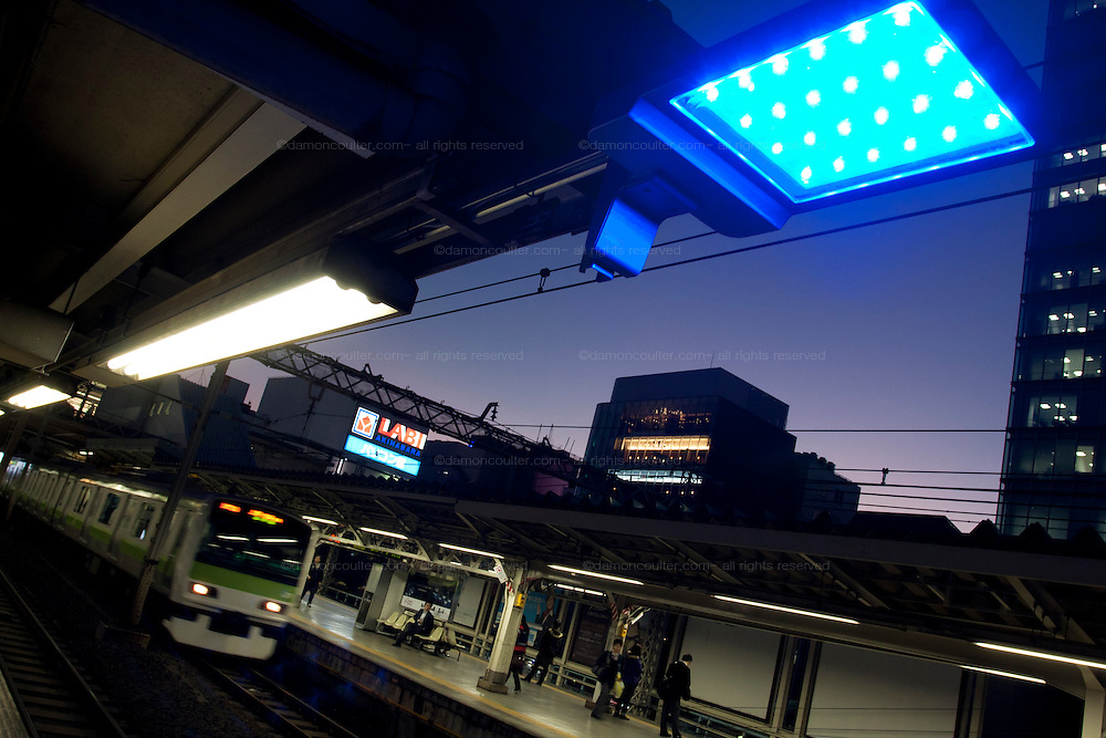 Blue lights installed at all 29 JR Yamanote Line stations for a cost of 15 million Yen (165,000 USD) in an effort to decrease suicides by people jumping under trains. Over 2,000 people jumped under trains in 2008, accounting for 6% of all suicides in the country. The blue LED lights are meant to calm and soothe potential jumpers, though there is little scientific evidence for this. Japan has one of the highest suicide rates in the world which the recent economic crisis has exacerbated. Kanda Station, Tokyo, Japan December 4th 2009