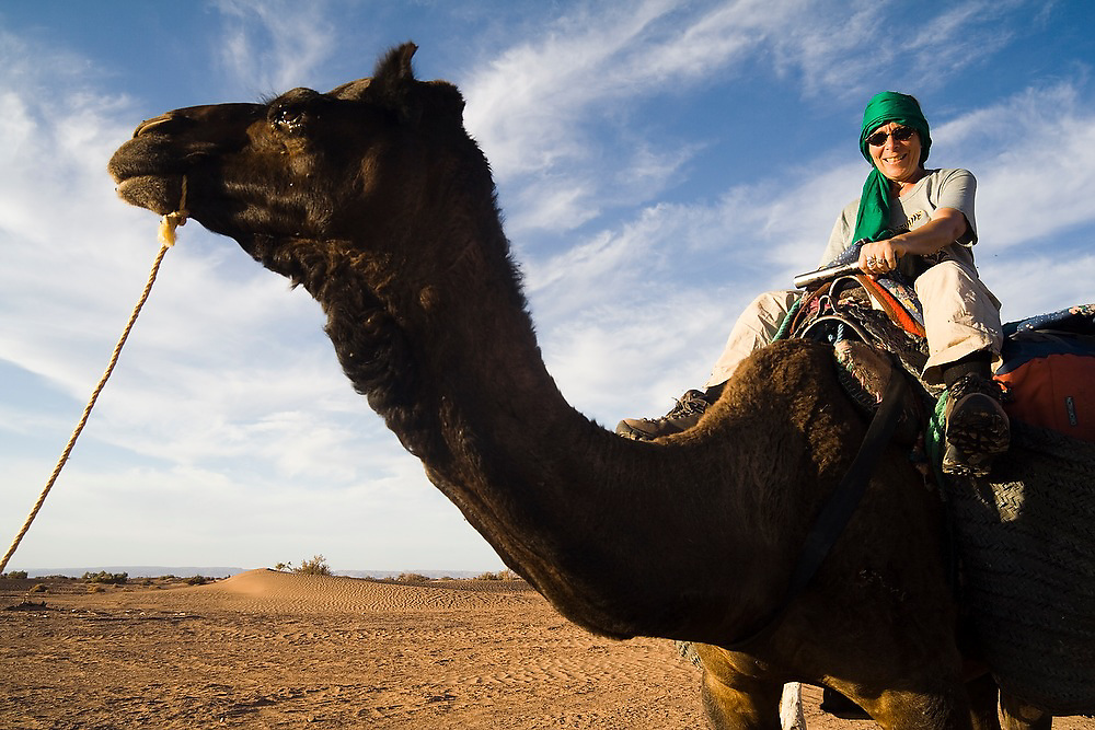 Liana Welty rides a camel on a three-day camel trek to the remote dunes of Erg Zehar, near M'hamid in the Moroccan Sahara.
