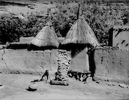 Dogon boy prepares a bath in a wooden tub, using a minimum of precious water, in Kani-Kombole, Mali.  The Dogon people maintain existence in the marginal, semi-arid Sahel lands that stretch in the Niger River watershed.