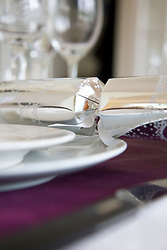 Close up of a place setting with Christmas cracker