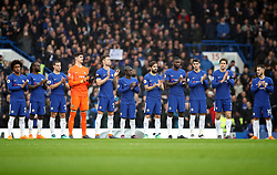 Chelsea players hold a minute applause for the late Ray Wilkins during the Premier League match at Stamford Bridge, London.