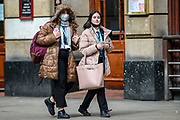 Following the government decision to reopen Britain, the picture shows people wearing face-covering masks carrying shopping bags and walking outdoors in the city of Manchester on Wednesday, April 28, 2021. Manchester is part of the UK to lift some of the restrictions designed to stop the spread of Covid-19. (Photo/ Vudi Xhymshiti)