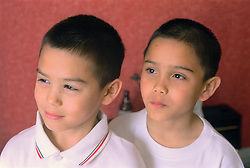 Portrait of twin boys standing together,