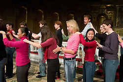 Stanford Chorale group massage between practice takes at Memorial Church.