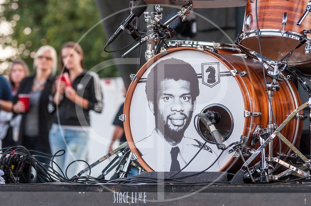 BALTIMORE United States - September 14, 2013: Kareem Abdul-Jabbar graces the drums of Gaslight Anthem drummer Benny Horowitz, during their performance at The Shindig, in Baltimore's historic Carroll Park