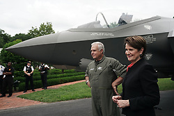 """ISP POOLWASHINGTON, DC - JULY 23: Chairman, President and CEO of Lockheed Martin Marillyn Hewson (R) and Director and Chief Test Pilot Alan Norman (L) wait for U.S. President Donald Trump's visit in front of an F-35 fighter jet during the 2018 Made in America Product Showcase July 23, 2018 at the White House in Washington, DC. The White House held the showcase to """"celebrates every state's effort and commitment to American-made products, and will allow these companies to speak with senior Administration officials, including the President, the Vice President, members of the Cabinet, and senior staff."""" (Photo by Alex Wong/Getty Images)"""