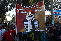 """October 14, 2017 - A """"Day of Rage"""" demonstration takes place in Anjara, in the western Aleppo countryside. The demonstration is part of a series of rallies in opposition-controlled territories of Syria calling for the fall of the Syrian regime of Bashar al-Assad, to denounce what they describe as the massacres committed by the Russian airplanes in Syria, as well as to remember those who died and went to prison as they joined the Syrian revolution (Credit Image: © Juma Mohammed/ImagesLive via ZUMA Wire)"""