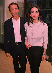 Fashion designer BEN DE LISI and MISS DEBBIE LOVEJOY, at a party in London on 21st April 1998.MGT 30