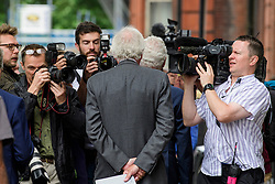 © Licensed to London News Pictures. 03/07/2017. London, UK. Former group chief executive of Barclays JOHN VARLEY is surrounded by media as he leaves Westminster Magistrates Court in London where he is charged with conspiracy to commit fraud. Barclays executives John Varley, Roger Jenkins, Thomas Kalaris and Richard Boath were charged by the Serious Fraud Office following events that took place at the height of the financial crisis, when Barclays avoided a taxpayer bailout by raising £11. 8bn in emergency funds from a number of major investors, including Qatar. Photo credit: Ben Cawthra/LNP