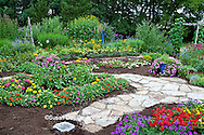 63821-21809 Flower garden with stone paths, obelisk, bird bath, & bird house.  Homestead Purple Verbena (Verbena canadensis), Red Verbena, New Gold Lantana (Lantana camara) Butterfly Bushes, Zinnias, Joe Pye Weed (Eupatorium purpureum)  Moon Vine on trellis, Marion Co., IL