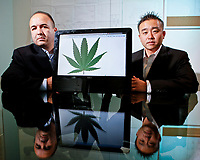 Daniel Jaimes and Jason Oh of Planned Property Management are planning to start a business that would provide rental space for pot growers. They are in their office with blueprints of a warehouse in Los Angeles, CA.  July 26, 2010. Photo by David Sprague