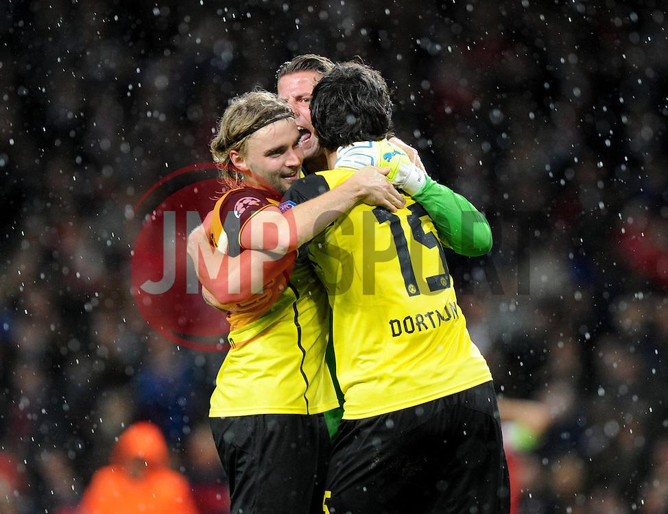 Borrusia Dortmund's Marcel Schmelzer celebrate there win over arsenal with goal keeper Borrusia Dortmund's Roman Weidenfeller - Photo mandatory by-line: Alex James/JMP - Tel: Mobile: 07966 386802 22/10/2013 - SPORT - FOOTBALL - Emirates Stadium - London - Arsenal v Borussia Dortmund - CHAMPIONS LEAGUE - GROUP F