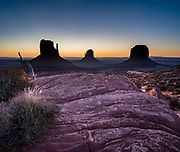 West & East Mittens and Merrick Butte at dawn in Monument Valley Navajo Tribal Park, Arizona, USA. The Western movie director John Ford set several popular films here. This image was stitched from multiple overlapping photos.