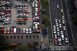 Traffic in downtown Mexico City.  Traffic and air pollution are a big problem in Mexico City.