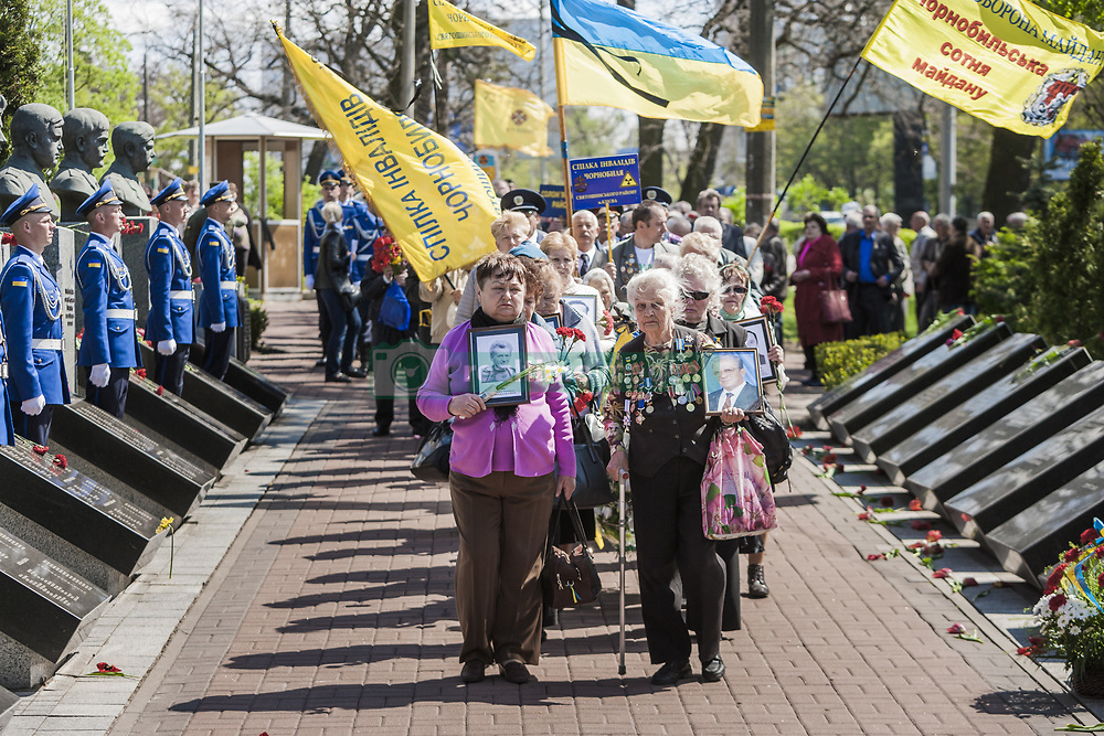 April 26, 2018 - Kiev, Ukraine - Widows of liquidators and firemen in the Chernobyl accident with photos of their husbands during the celebrations in Kiev of the 32nd anniversary of the Chernobyl  nuclear accident, Ukraine. (Credit Image: © Celestino Arce via ZUMA Wire)