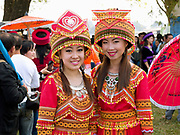Portrait of two young Hmong Der (White Hmong) women wearing contemporary Hmong traditional costume at Ban Km 52 Hmong New Year festival, Vientiane province, Lao PDR. The Hmong celebration of New Year is based on the lunar calendar. This important time is an opportunity to honour ancestors and spirits through offerings and rituals and to partake in games, sports, feasts, shows, bullfights and courtship. The Hmong are the third largest ethnic group in Laos. One of the most ethnically diverse countries in Southeast Asia, Laos has 49 officially recognised ethnic groups although there are many more self-identified and sub groups. These groups are distinguished by their own customs, beliefs and rituals.