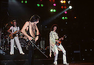 LOS ANGELES, CA - FEBRUARY 25: John Deacon, Roger Taylor, Freddie Mercury and Brian May of Queen in concert at The Forum on February 25, 1977 in Los Angeles, California.