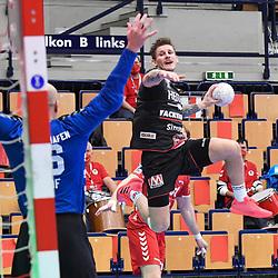 Erlangens Hampus Olsson gegen Ludwigshafens Skof Gorazd (Nr.16)  beim Spiel in der Handball Bundesliga, Die Eulen Ludwigshafen - HC Erlangen.<br /> <br /> Foto © PIX-Sportfotos *** Foto ist honorarpflichtig! *** Auf Anfrage in hoeherer Qualitaet/Aufloesung. Belegexemplar erbeten. Veroeffentlichung ausschliesslich fuer journalistisch-publizistische Zwecke. For editorial use only.