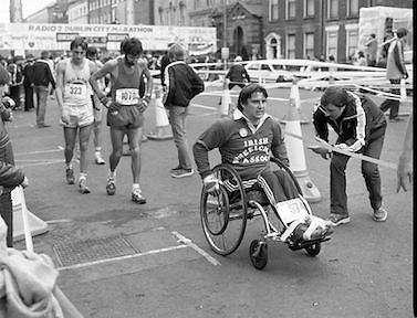 Finish of Dublin City Marathon .25/10/1982  Radio 2, Dublin City Marathon..1982.25.10.1982.10.25.1982.25th October 1982..The Radio 2 sponsored Dublin City Marathon finish at St Stephens Green Dublin..The overall winners were:Men, Gerry Kiernan,Listowel, Kerry. Women, Debbie Mueller,U.S.A. and the first wheelchair competitor Michael O'Rourke..Michael is congratulated on his win.