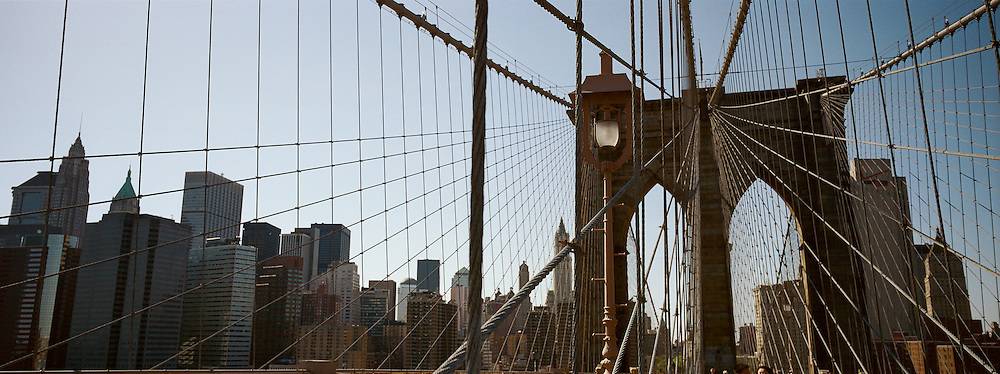 A panoramic view of the Brooklyn Bridge showing downtown Manhattan in the background. New York City, USA. 23rd July 2011. Photo Tim Clayton