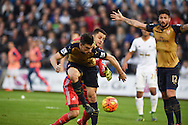 Laurent Koscielny of Arsenal beats Swansea goalkeeper Lukasz Fabianski to score his teams 2nd goal. Barclays Premier league match, Swansea city v Arsenal  at the Liberty Stadium in Swansea, South Wales  on Saturday 31st October 2015.<br /> pic by  Andrew Orchard, Andrew Orchard sports photography.
