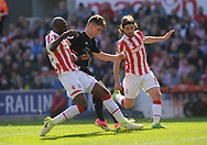 Liverpool's Ben Woodburn battles for the ball with Stoke city's Joe Allen and Bruno Martins Indi .Premier league match, Stoke City v Liverpool at the Bet365 Stadium in Stoke on Trent, Staffs on Saturday 8th April 2017.<br /> pic by Bradley Collyer, Andrew Orchard sports photography.