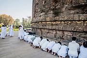 Worshipers at the Dhamekh Stupa, Sarnath where Gautama Buddha first taught the Dharma, Near Varanasi India