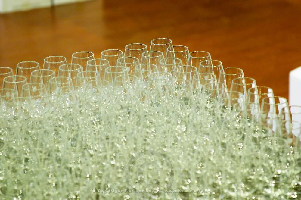 Hundreds of wine tasting glasses on a table ready for winetasters at a professional tasting at the wine shop Lavinia in Paris.