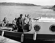 The Irish Photo Archive requests all the people to invite their friends and family that lives overseas to join this great gathering, sitting in a old boat like you see in this picture and watch the beautiful Grand Canal.
