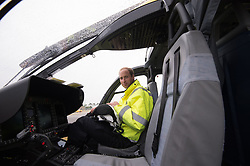 The Duke of Cambridge sits in the cockpit of his helicopter as he begins his new job with the East Anglian Air Ambulance (EAAA) at Cambridge Airport.