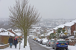 © Licensed to London News Pictures 09/02/2021.        Bromley, UK. Two people out walking in the icy conditions. The snow continues to fall in the Borough of Bromley, South East London today. Weather warnings remain in place across the UK for more freezing cold snowy weather. Photo credit:Grant Falvey/LNP