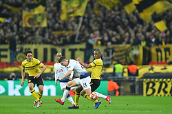 February 13, 2019 - London, England, United Kingdom - Tottenham defender Juan Foyth is put under pressure by Borussia Dortmund defender Abdou Diallo during the UEFA Champions League match between Tottenham Hotspur and Ballspielverein Borussia 09 e.V. Dortmund at Wembley Stadium, London on Wednesday 13th February 2019. (Credit: Jon Bromley | MI News & Sport Ltd) (Credit Image: © Mi News/NurPhoto via ZUMA Press)