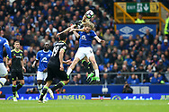 Nemanja Matic of Chelsea jumps above Tom Davies of Everton. Premier league match, Everton v Chelsea at Goodison Park in Liverpool, Merseyside on Sunday 30th April 2017.<br /> pic by Chris Stading, Andrew Orchard sports photography.