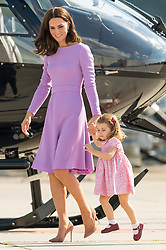 Princess Charlotte skips as she walks with the Duchess of Cambridge at the Airbus factory, in Hamburg, Germany.