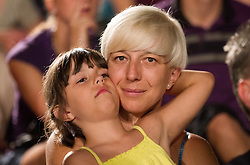 Mother with daughter during men final match of Slovenian National Championship in beach volleyball Kranj 2012, on June 30, 2012 in Kranj, Slovenia. (Photo by Vid Ponikvar / Sportida.com)