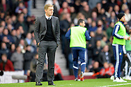 Swansea City Manager Garry Monk watches his players from the touch line. Barclays Premier league match, West Ham Utd v Swansea city at the Boleyn ground, Upton Park in London on Sunday 7th December 2014.<br /> pic by John Patrick Fletcher, Andrew Orchard sports photography.