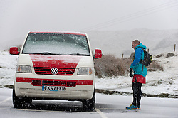 © Licensed to London News Pictures. 29/01/2019. Snowdonia, Gwynedd, Wales, UK. A brave fell unner returns to the Pen-Y-Pass car park after having run up to the summit of Snowdon and back before breakfast as heavy snow hits Snowdonia National Park, Gwynedd, Wales, UK. credit: Graham M. Lawrence/LNP