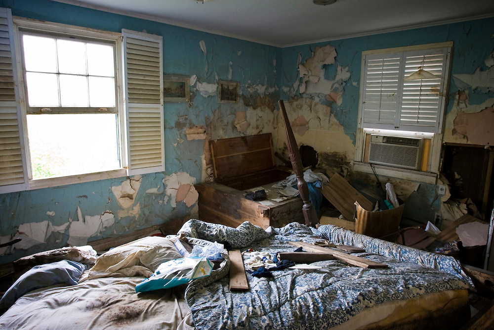 A bedroom of a home in the Lakeview area that suffered major damage due to Hurricane Katrina flooding in New Orleans, Louisiana. Many of these homes' interiors remain untouched; floors are covered in flood debris and rubble while the walls and surfaces are still scab-covered layers of mold.