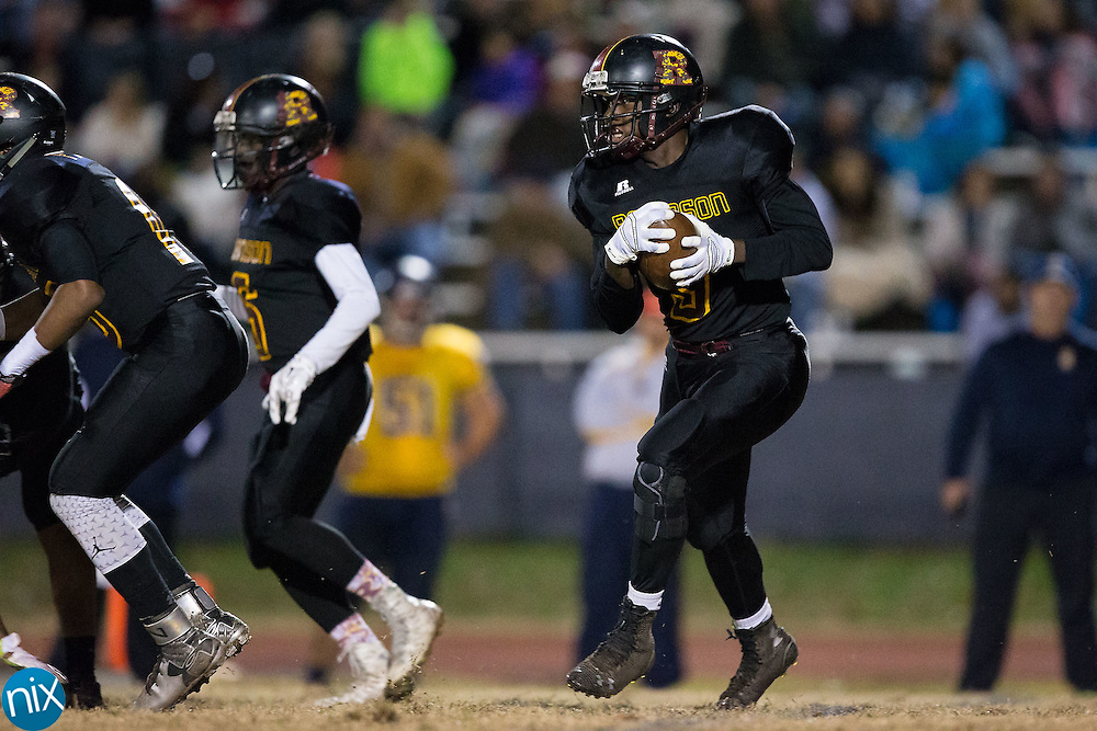 Jovante Misenheimer (9) of the JM Robinson Bulldogs looks for running room during first half action against the South Iredell Vikings at South Iredell High School November 20, 2015, in Statesville, North Carolina.  The Vikings defeated the Bulldogs 14-13.  (Brian Westerholt/Special to the Tribune)