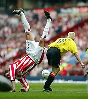 Photograph: Scott Heavey<br />Watford V Southampton<br />13/04/03<br />Claus Lundekvam takes a tumble over Heidar Helguson during this FA Cup Semi-Final match.