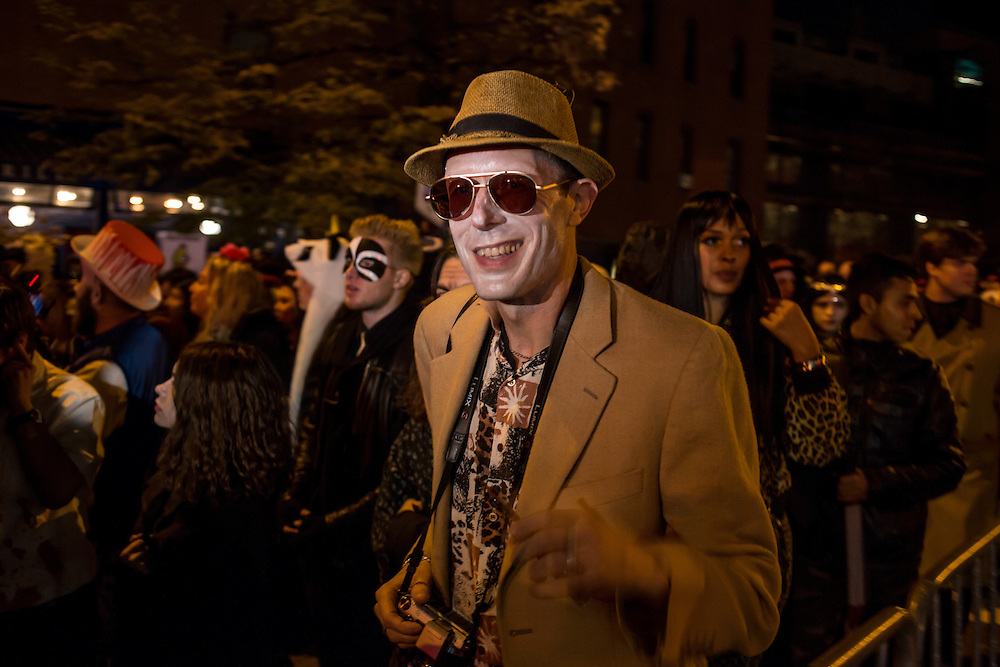 New York, NY - 31 October 2015. A man dressed as gonzo journalist Hunter S. Thompson, complete with fedora, camera and a smoke,  in the annual Greenwich Village Halloween Parade.