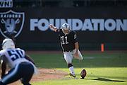 Oakland Raiders kicker Sebastian Janikowski (11) kicks the ball against the Tennessee Titans at Oakland Coliseum in Oakland, Calif., on August 26, 2016. (Stan Olszewski/Special to S.F. Examiner)