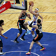 ORLANDO, FL - APRIL 12: R.J. Hampton #13 of the Orlando Magic splits the defense of Quinndary Weatherspoon #15, Devin Vassell #24  and Tre Jones #33 of the San Antonio Spurs during the second half at Amway Center on April 12, 2021 in Orlando, Florida. NOTE TO USER: User expressly acknowledges and agrees that, by downloading and or using this photograph, User is consenting to the terms and conditions of the Getty Images License Agreement. (Photo by Alex Menendez/Getty Images)*** Local Caption *** R.J. Hampton; Quinndary Weatherspoon; Devin Vassell; Tre Jones
