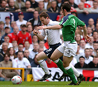 Fotball<br /> VM-kvalifisering<br /> England v Nord Irland<br /> 26. mars 2005<br /> Foto: Digitalsport<br /> NORWAY ONLY<br /> England's Wayne Rooney and Northern Ireland's Tony Capaldi battle for the ball.