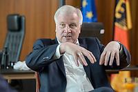 01 JUL 2019, BERLIN/GERMANY:<br /> Horst Seehofer, CSU, Bundesinnenminister, waehrend einem Interview, in seinem Buero, Bundesministerium des Inneren<br /> IMAGE: 20190701-01-036<br /> KEYWORDS: Büro