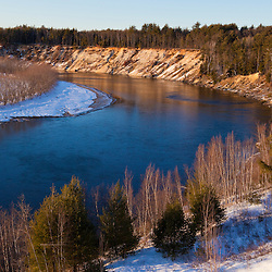 The view from a bluff overlooking the Merrimack River in Canterbury, New Hampshire. Winter.