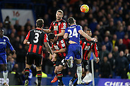 Simon Francis of Bournemouth heads the ball out over Gary Cahill of Chelsea. Barclays Premier league match, Chelsea v AFC Bournemouth at Stamford Bridge in London on Saturday 5th December 2015.<br /> pic by John Patrick Fletcher, Andrew Orchard sports photography.